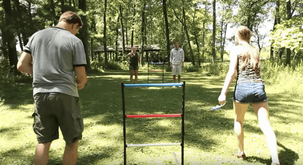group of friends playing ladder ball