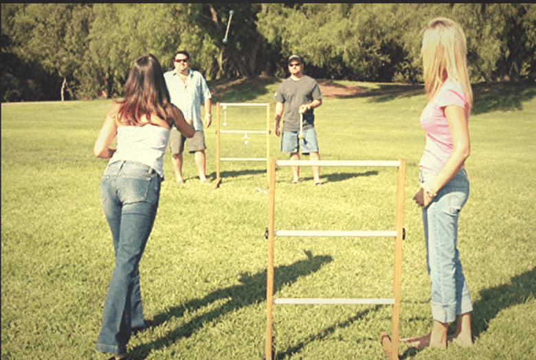 four people ladder ball game in the backyard