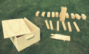 kubb game set and box laid on grass