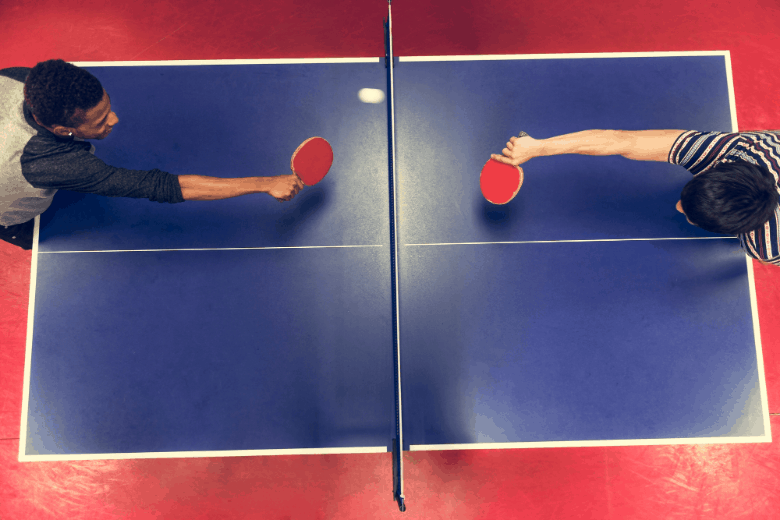 friends playing ping pong seen from top