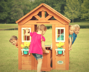 kids playing outdoors in timberlake playhouse