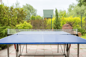 Blue ping pong table outdoors