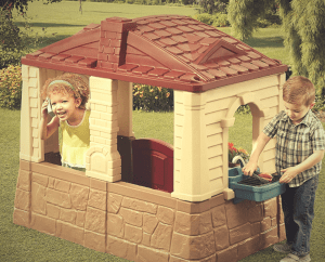two kids playing in the neat and tidy playhouse