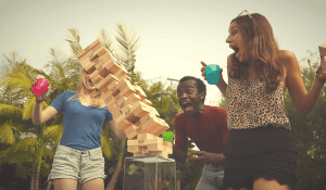 playing jenga giant outdoors
