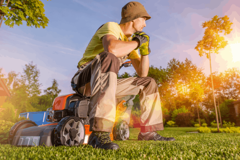 Men Watching His Small Lawn While Seating on His Lawn Mower